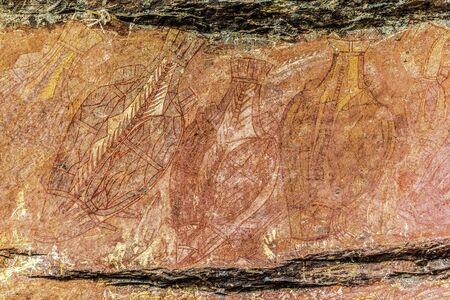 Ancient Aboriginal Art: hand prints, animal herds, spiral in a cave, Kakadu National park, australia
