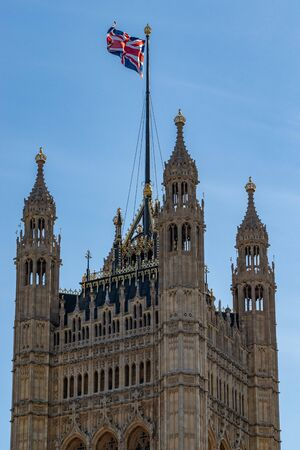 Great Britain flag on top of the Palace of Westminster known as Houses of Parliament, London, UK