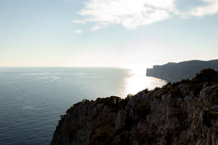 aerial view over Rocks, cliffs, island and sea water during sunset from the view point cap andritxol in Camp de Mar, Majorca island, Spain