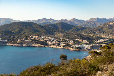 aerial view over the bay of camp de mar during sunset from the view point cap andritxol, mallorca, Spain 免版税图像