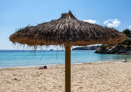 beach umbrellas on Palmanova beach in Calvia Bol ses Taules Mallorca, spain 版權商用圖片