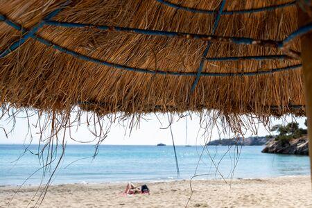 beach umbrellas on Palmanova beach in Calvia Bol ses Taules Mallorca, spain 免版税图像