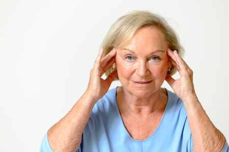 Senior woman wearing blue shirt while showing her face Effect of Aging Caused by loss of elasticity closeup Archivio Fotografico