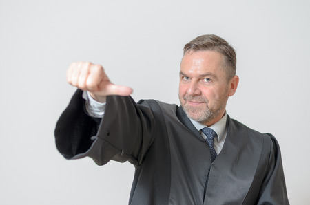 abstention: Businessman giving a thumbs to side gesture of equality or equal voting signaling it si soso
