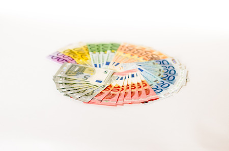 denominations: Fanned Euro notes of different denominations arranged in a colorful circle on a white background in a conceptual financial, economic or banking image