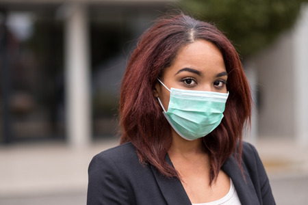 afroamerican: Close up Young Afro-American Businesswoman Wearing Protecting Mask, Staring at the Camera. Stock Photo