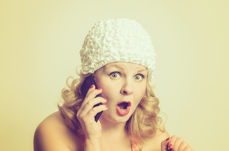 open girl: Shocked Young Woman Talking to Someone Over the Mobile Phone, pin-up style Stock Photo