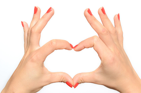 Woman Making A Heart Gesture With Her Fingers Symbolic Of Love