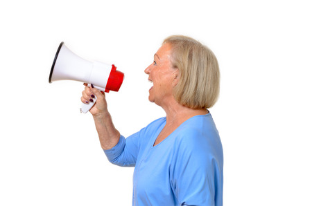 amplify: Profile of a senior woman using a megaphone to amplify her voice,conceptual of a protest, public speaking, rally or giving orders, upper body isolated on white