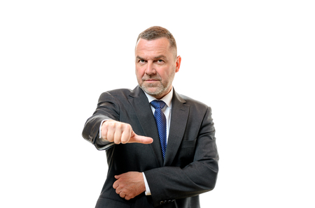 abstention: Stern businessman indicating his neutrality with a hand gesture as he decides to abstain from voting, upper body on white