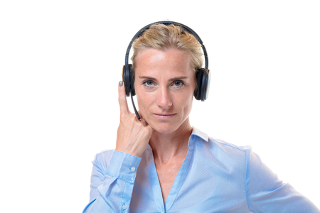 short haired: Single gorgeous short haired blond woman with telephone headset on head and finger holding side over white background Stock Photo