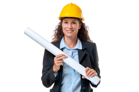 structural engineers: Happy confident young female architect or structural engineer wearing a hardhat and stylish jacket standing holding a blueprint, isolated on white Stock Photo