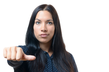 indifferent: Woman giving an equal thumb gesture with a grimace showing that she is undecided, abstaining, impartial or indifferent in a vote, upper body over white