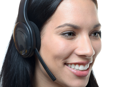 personal call: Smiling attractive friendly young business woman wearing a headset conceptual of a receptionist, personal assistant , client services or call center, head shot on white Stock Photo