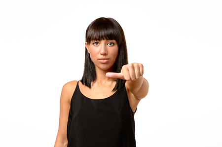 undecided: Woman giving an equal thumb gesture with a grimace showing that she is undecided, abstaining, impartial or indifferent in a vote, upper body over white