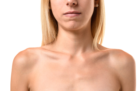 protruding: Protruding collar bones of an anorexic young woman in a closeup view isolated on white conceptual of eating disorders