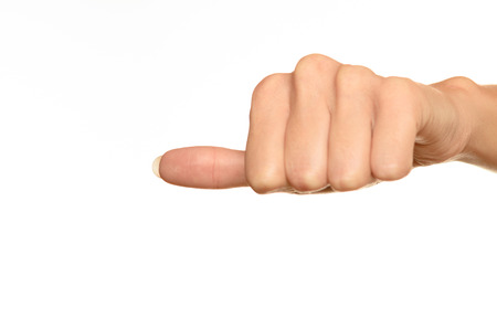front view of female hand showing thumbs to side sign against white background