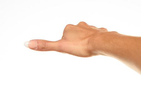 back view of female hand showing thumbs to side sign against white background Stock Photo