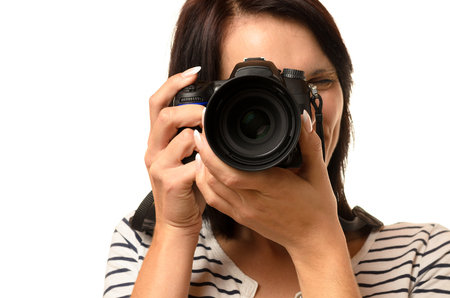 reflex camera: Close up of single woman pointing a professional single lens reflex camera over white background