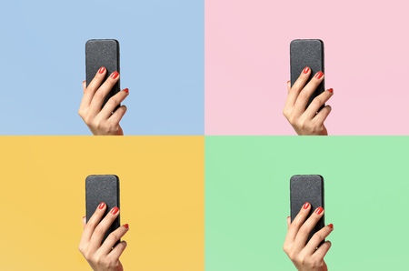 varnished: Woman with varnished red fingernails holding up a mobile phone on four different colors of background with copy space