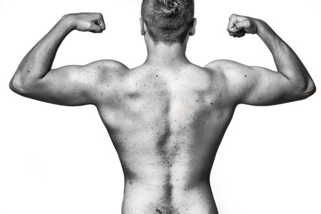 Fit Muscular Young Man Flexing His Muscles Raising His Arms With