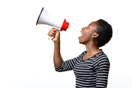 Young african woman shouting into a megaphone, side view on white conceptual of a rally or protest