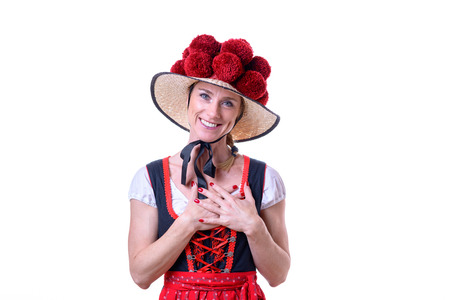Black forest woman showing her heartfelt gratitude and thanks clasping her hands to her heart with a pleased smile