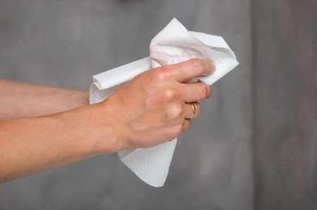 Close up view of female hands holding white towel