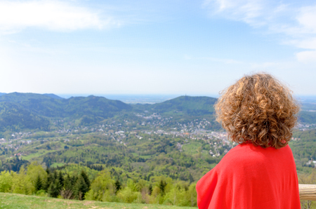 Woman tourist looking out over the Black Forest region in Germany on a sunny day