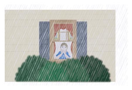Sad boy watching the rain from window