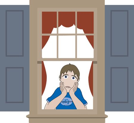 Young man with hands to chin sits inside window Stock Photo
