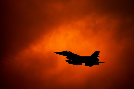 aeronautical: F-16 on orange sky Stock Photo