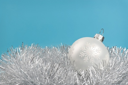 White Christmas bauble over blue background