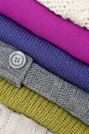 cable stitch: Stack of colorful sweaters Stock Photo