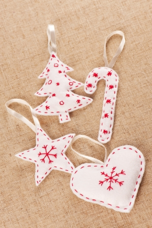 A set of white felt handmade Xmas decorations Stock Photo - 16766039