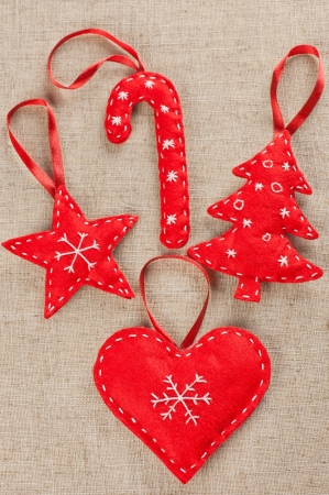 A set of red felt handmade Xmas decorations