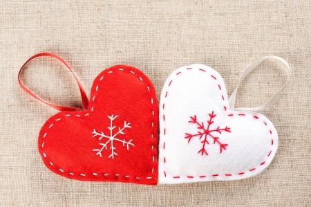 Red and white hearts handmade of felt Stock Photo - 16766040