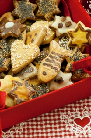 Christmas cookies in a red fabric bowl Stock Photo
