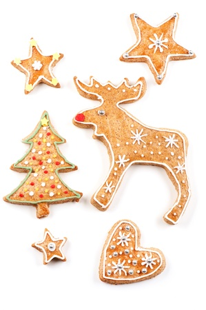 Decorated gingerbread Christmas cookies on white background