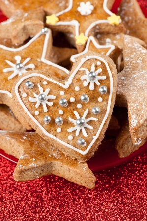 Homebaked Christmas cookies on a red glitter background Stock Photo