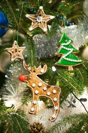 Homebaked gingerbread cookies on Christmas Tree Stock Photo