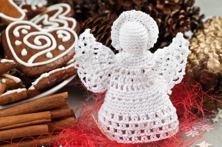 Handmade Christmas Crochet Angel with a halo Stock Photo