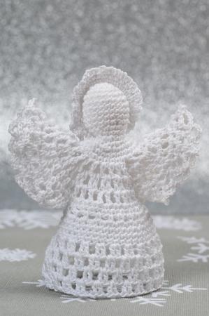 Handmade Christmas Crochet Angel on silver background