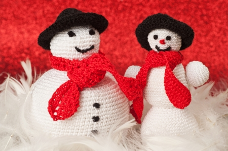 Fat and skinny crochet snowmen Stock Photo