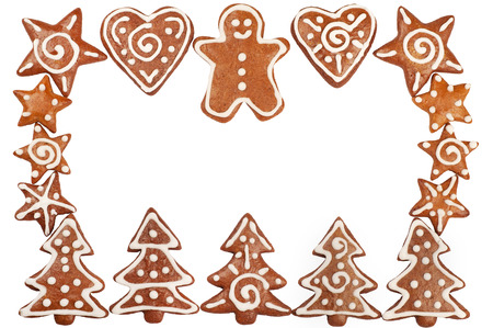 Homebaked Christmas Gingerbread Cookies border isolated on white Stock Photo