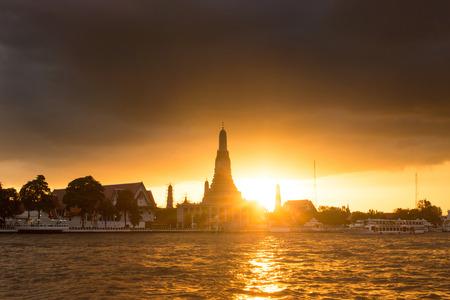 Silhouette of Wat Arun  in Bangkok Thailand photo