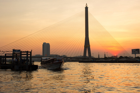 rama: Sunset The Rama 8 Bridge in Bangkok Thailand Stock Photo