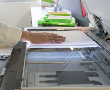 xerox: Man copying paper from Photocopier Stock Photo