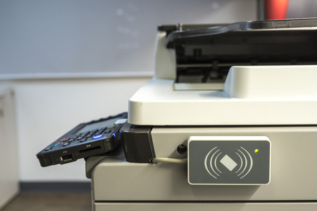 xerox: access control for scanning key card to access  Photocopier. Stock Photo