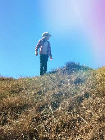 Girl on top of a hill looking into the distance